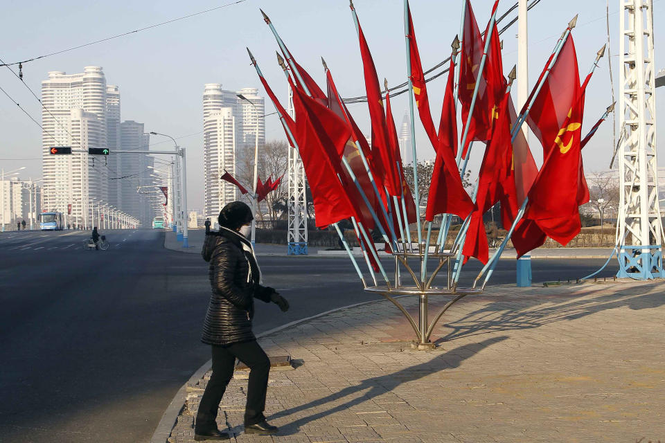 A person passes by a bouquet of Workers Party flags along a main street of the Central District in Pyongyang, North Korea, on Wednesday, Jan. 6, 2021.