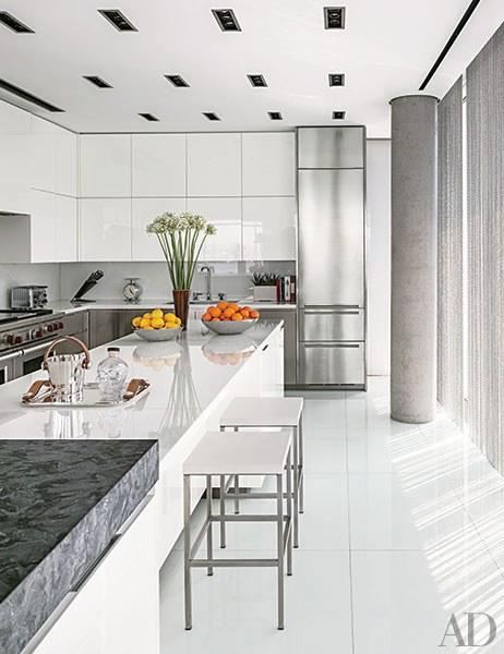 "A <a rel=""nofollow"" href=""http://www.architecturaldigest.com/story/tony-ingrao-randy-kemper-manhattan-apartment-article?mbid=synd_yahoo_rss"">Manhattan, kitchen</a> in a sleek building by Richard Meier has glamorous shiny countertops of white crystallized glass."