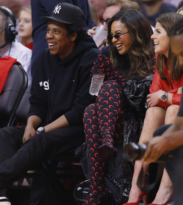 Jay-Z and Beyonce watch from courtside during Game Six of the Western Conference Semifinals of the 2019 NBA Playoffs at Toyota Center on May 10, 2019 in Houston, Texas. (Photo by Bob Levey/Getty Images)
