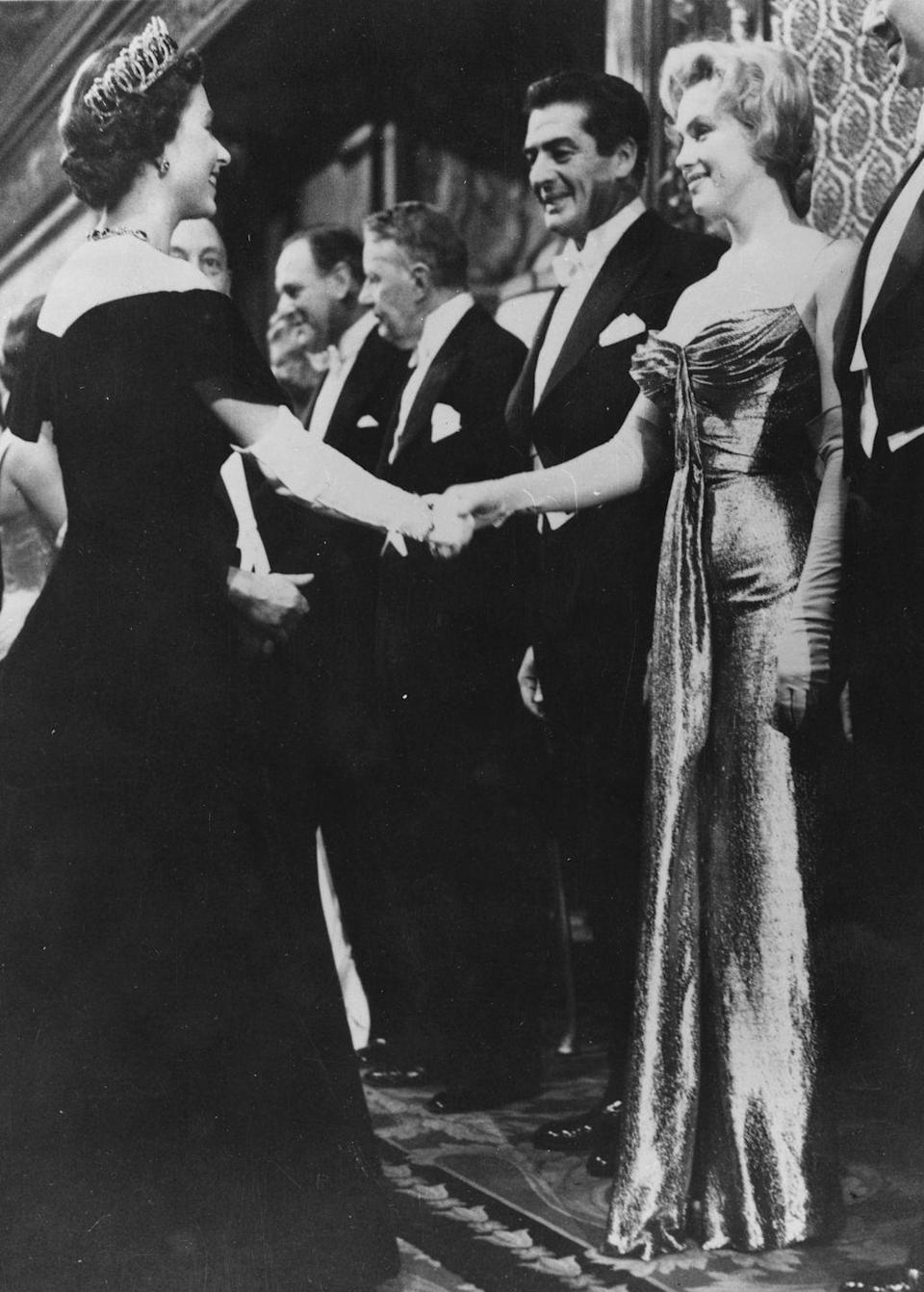 <p>For her royal moment, Marilyn Monroe opted for a strapless gown with elbow-high silk gloves. Sexy, of course, but tasteful too.</p>