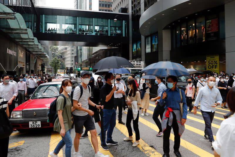 Anti-government demonstrators take part in a protest during a lunch time in Hong Kong