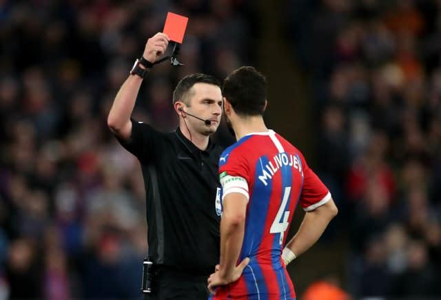 Luka Milivojevic was shown a red card by referee Michael Oliver after using the pitchside monitor (Bradley Collyer/PA)