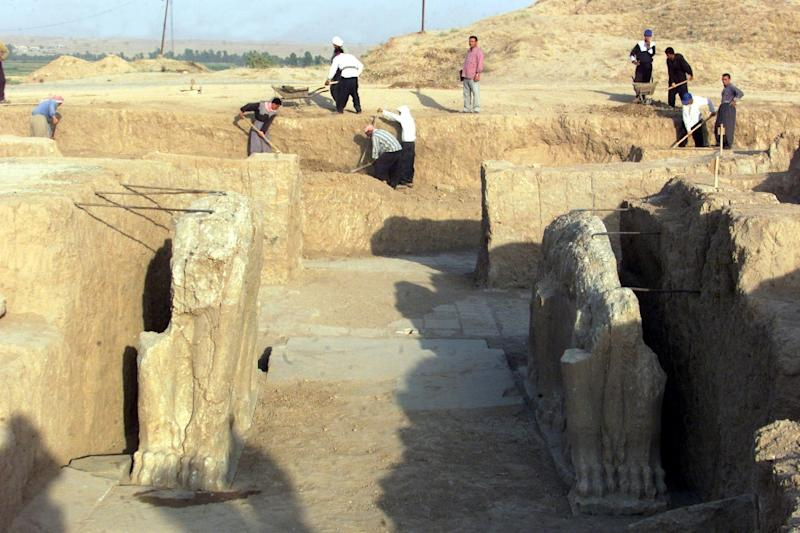 A picture taken on July 17, 2001 shows Iraqi workers cleaning an archeological site in Nimrud