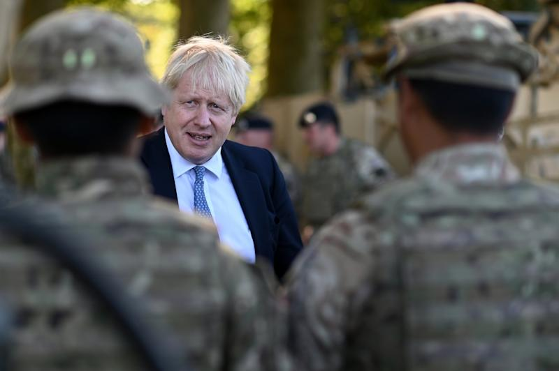 Boris Johnson meets military personnel in Salisbury on Thursday (Ben Stansall)