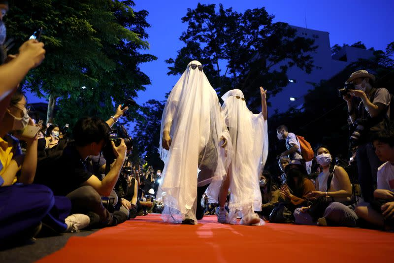 Protesters perform on a red carpet while taking part in a protest against the government and to reform monarchy in Bangkok