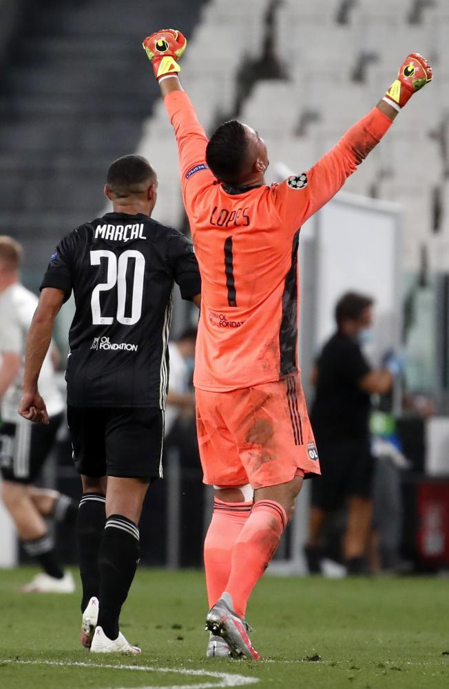 Lyon's goalkeeper Anthony Lopes celebrates after the Champions League last-16 second leg against Juventus