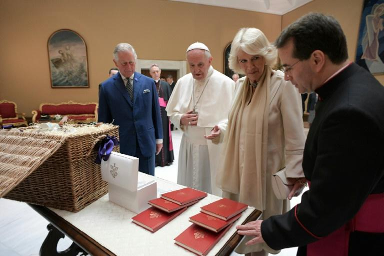 Pope Francis (C) exchanges gifts with Britain's Prince Charles and his wife Camilla, Duchess of Cornwall during a private audience on April 4, 2017 at the Vatican