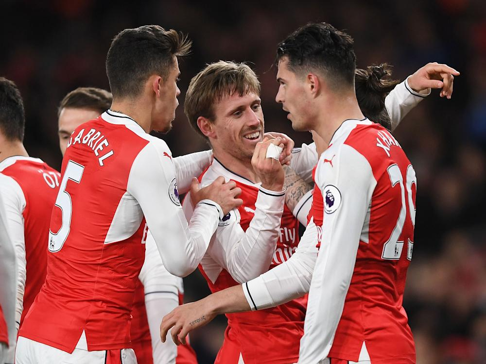 Arsenal's players celebrate following their late winner: Getty