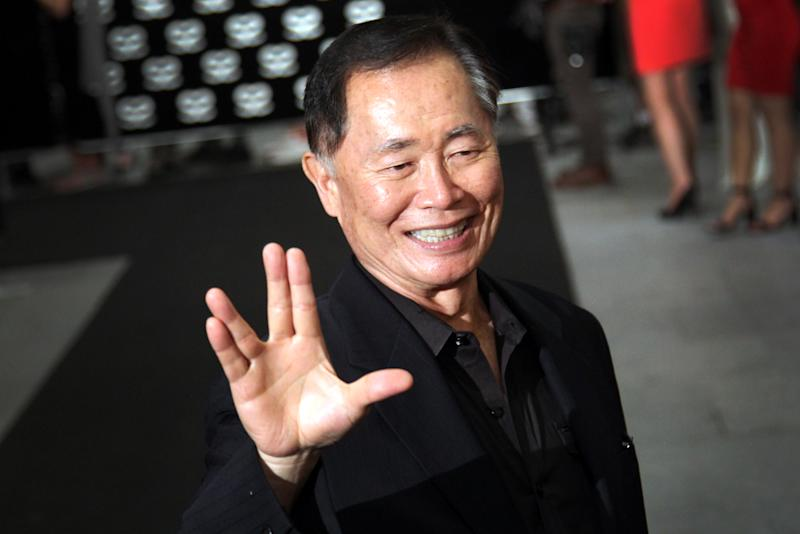 """FILE - This May 23, 2013 file photo shows actor George Takei gesturing with a hand greeting made popular by the TV series """"Star Trek"""" at the Marina Bay Sands hotel in Singapore for the inaugural Social Star Awards. Takei will serve as grand marshal of Cincinnati's annual Oktoberfest-Zinzinnati. The 76-year-old actor will lead the chicken dance Sept. 21. (AP Photo/Wong Maye-E, File)"""
