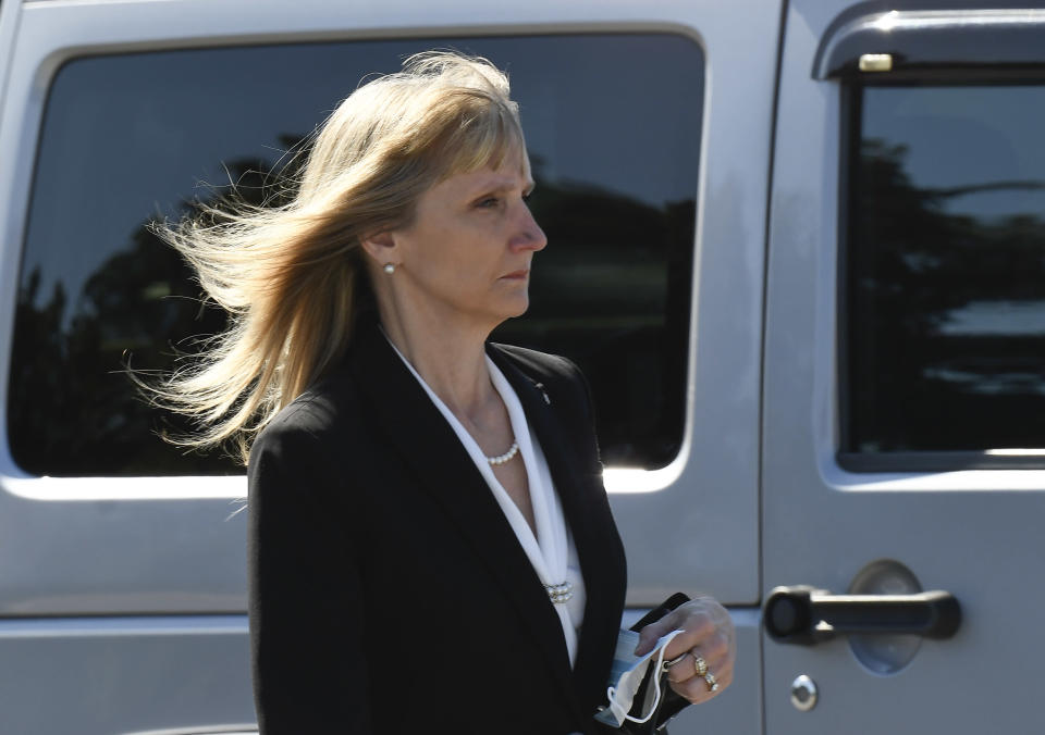 Schoharie County District Attorney Susan Mallery is seen walking to a converted courtroom at the Schoharie High School gymnasium to accommodate more people during the trial of Nauman Hussain, who is charged with 20 counts of second degree manslaughter and criminally negligent homicide in the 2018, limousine crash Thursday, Sept. 2, 2021, in Schoharie, N.Y. (AP Photo/Hans Pennink)