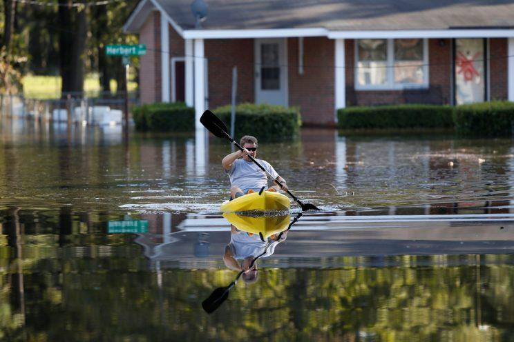 Parker Uzzell checks on his property with a kayak after the effects from Hurricane Matthew in Goldsboro, N.C., on Oct. 12, 2016. (Photo: Randall Hill/Reuters)