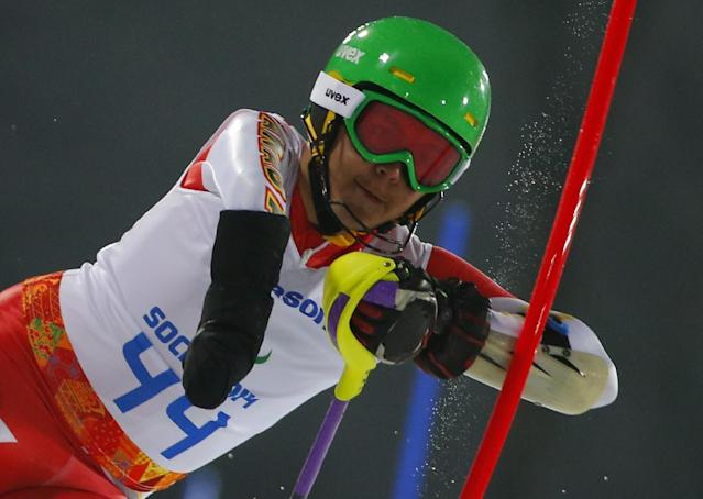 Kirk Schornstein of Canada competes during the men's alpine skiing, slalom, standing event at the 2014 Winter Paralympic, Thursday, March 13, 2014, in Krasnaya Polyana, Russia. (AP Photo/Dmitry Lovetsky)