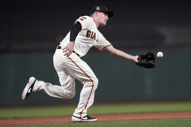 San Francisco Giants third baseman Corban Joseph fields a grounder hit by Pittsburgh Pirates' Dario Agrazal during the fifth inning of a baseball game Wednesday, Sept. 11, 2019, in San Francisco. Agrazal was out at first base. (AP Photo/Tony Avelar)
