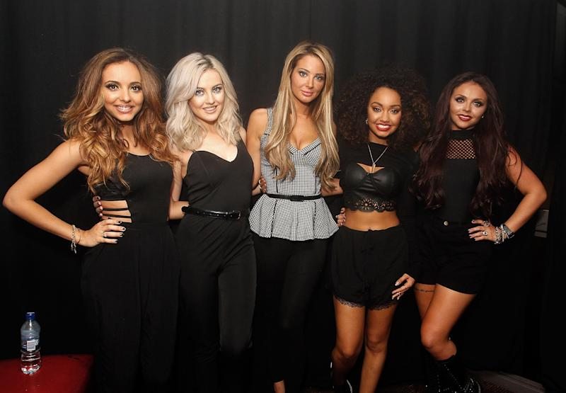 LONDON, UNITED KINGDOM - NOVEMBER 09: Jade Thirlwall, Perrie Edwards, Tulisa Contostavios, Leigh Anne Pinnock and Jesy Nelson of Little Mix pose backstage at Heaven on November 9, 2013 in London, United Kingdom. (Photo by Jo Hale/Redferns via Getty Images)