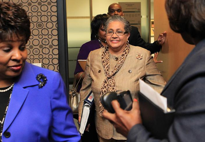 FILE - In this June 13, 2011 file photo, outgoing schools superintendent, Dr. Beverly Hall, center, arrives for her last Atlanta school board meeting at the Atlanta Public Schools headquarters in Atlanta. Hall and nearly three dozen other administrators, teachers, principals and other educators were indicted Friday, March 29, 2013, in one of the nation's largest cheating scandals. (AP Photo/Atlanta Journal-Constitution, Curtis Compton) MARIETTA DAILY OUT; GWINNETT DAILY POST OUT; LOCAL TV OUT; WXIA-TV OUT; WGCL-TV OUT