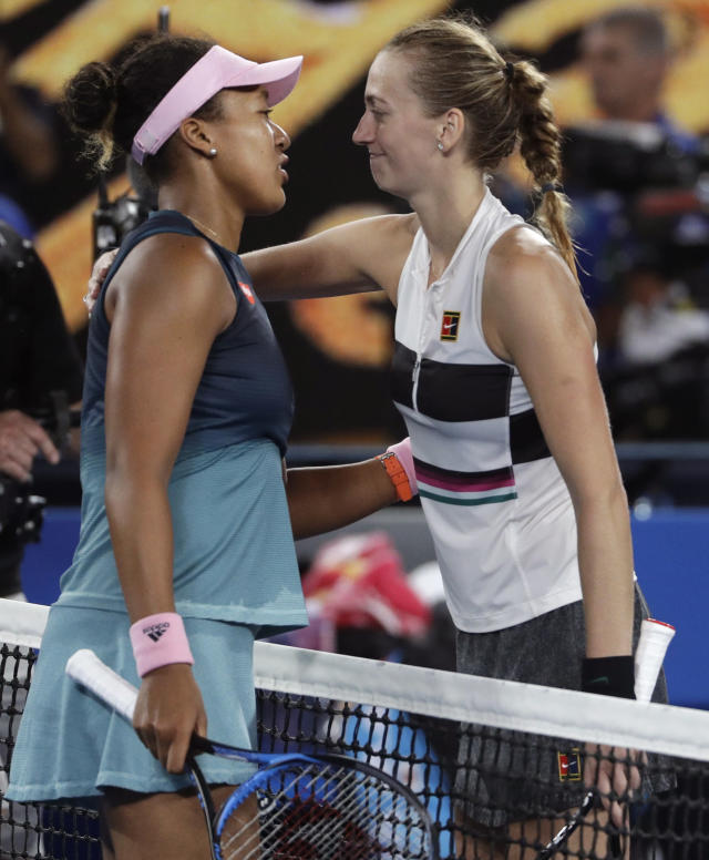 Japan's Naomi Osaka, left, is congratulated by Petra Kvitova of the Czech Republic after winning their women's singles final at the Australian Open tennis championships in Melbourne, Australia, Saturday, Jan. 26, 2019. (AP Photo/Mark Schiefelbein)