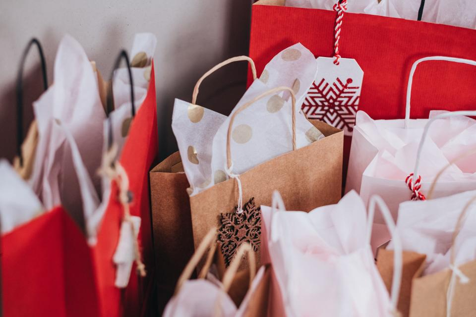Spending on Christmas gifts is predicted to go down, while spending on decorations will likely increase, report says. (freestocks/Unsplash)