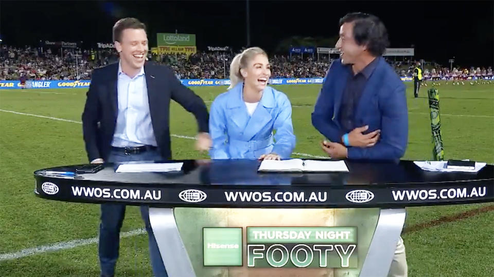 James Bracey and Allana Ferguson, pictured here revealing the gag to Johnathan Thurston.