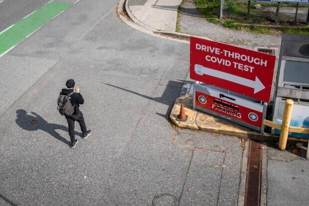 A person walks by the entrance to a private COVID-19 rapid testing site in Vancouver, British Columbia on Monday, Oct. 4, 2021.  (Ben Nelms/CBC - image credit)