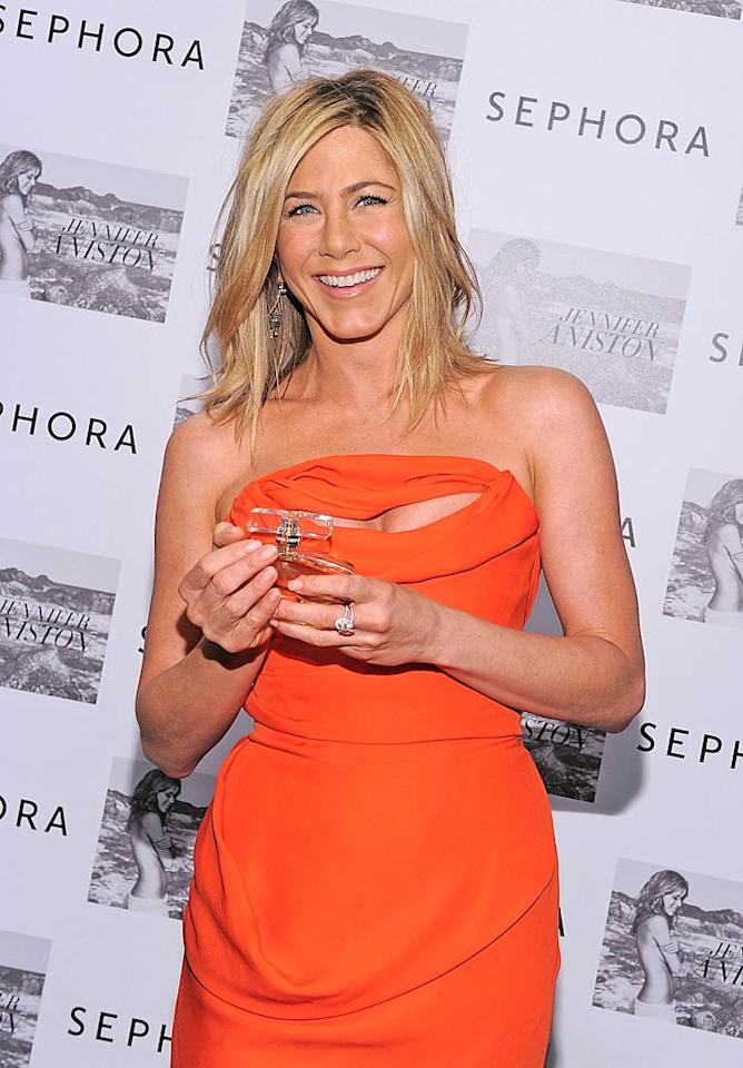 "Rocking a tangerine Vivienne Westwood dress, new fragrancier Jennifer Aniston signed bottles of her perfume, aptly called ""Jennifer Aniston,"" at a New York Sephora on Cinco de Mayo. Maybe skipping the chips and margaritas is how Jen stays so svelte ... Mike Coppola/<a href=""http://www.gettyimages.com/"" target=""new"">GettyImages.com</a> - May 5, 2011"