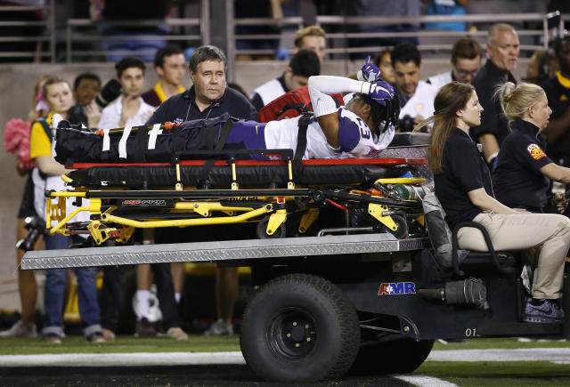 "Washington defensive back <a class=""link rapid-noclick-resp"" href=""/ncaaf/players/251217/"" data-ylk=""slk:Jordan Miller"">Jordan Miller</a> (23) is carted off the field due to injury during the second half of an NCAA college football game against Arizona State Saturday, Oct. 14, 2017, in Tempe, Ariz. Arizona State defeated Washington 13-7. (AP Photo/Ross D. Franklin)"