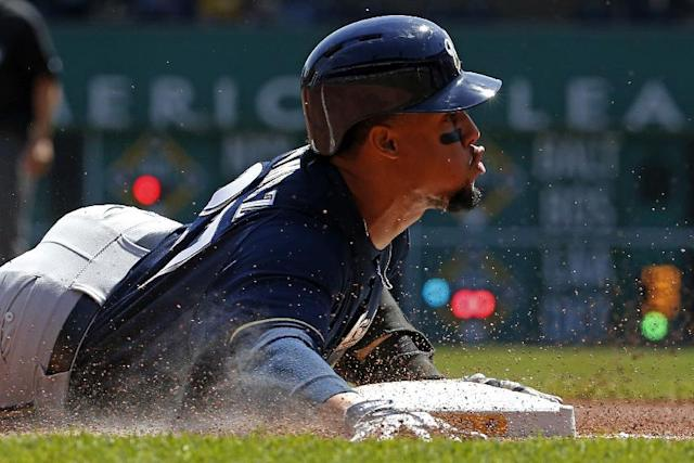 Milwaukee Brewers' Carlos Gomez slides into third with a triple during the third inning of a baseball game against the Pittsburgh Pirates in Pittsburgh Sunday, April 20, 2014. (AP Photo/Gene J. Puskar)