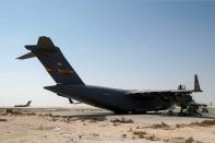 U.S. Air Force planes, which were used to evacuate people from Afghanistan, are seen at Al Udeid airbase in Doha
