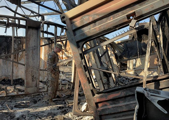 A photo taken on January 13, 2020, during a press tour organized by the US-led coalition which was fighting with the tales of the Islamic State group, shows a scene of damage at Ain al-Asad's military airfield, containing US and foreign troops in Iraq.