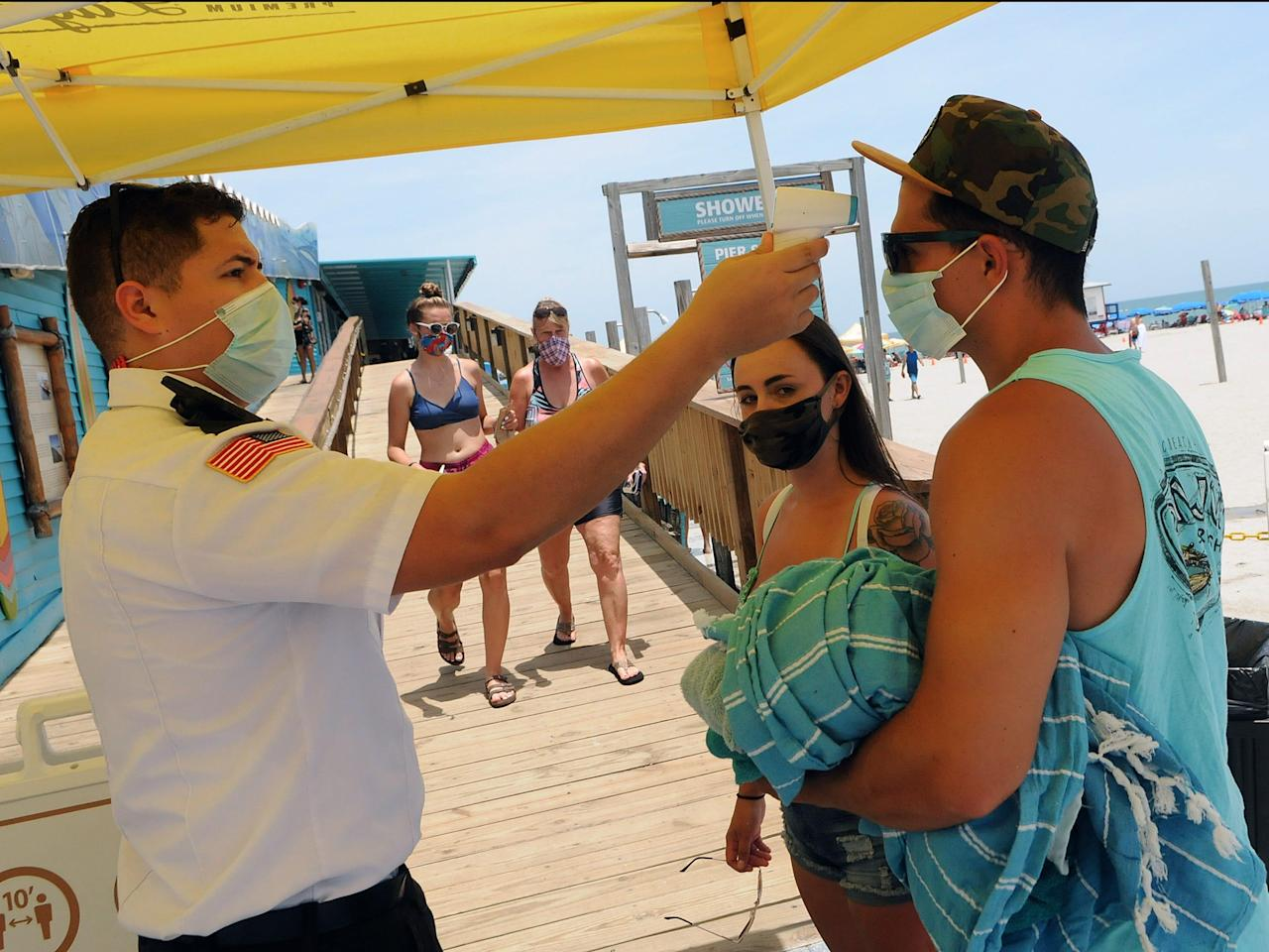 Florida and Texas each hit report highs for brand spanking new coronavirus circumstances on Saturday as outbreaks preserve surging within the South