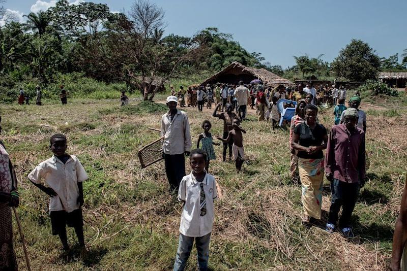 Residents of Uma leave a community center following a meeting with traveling doctors.