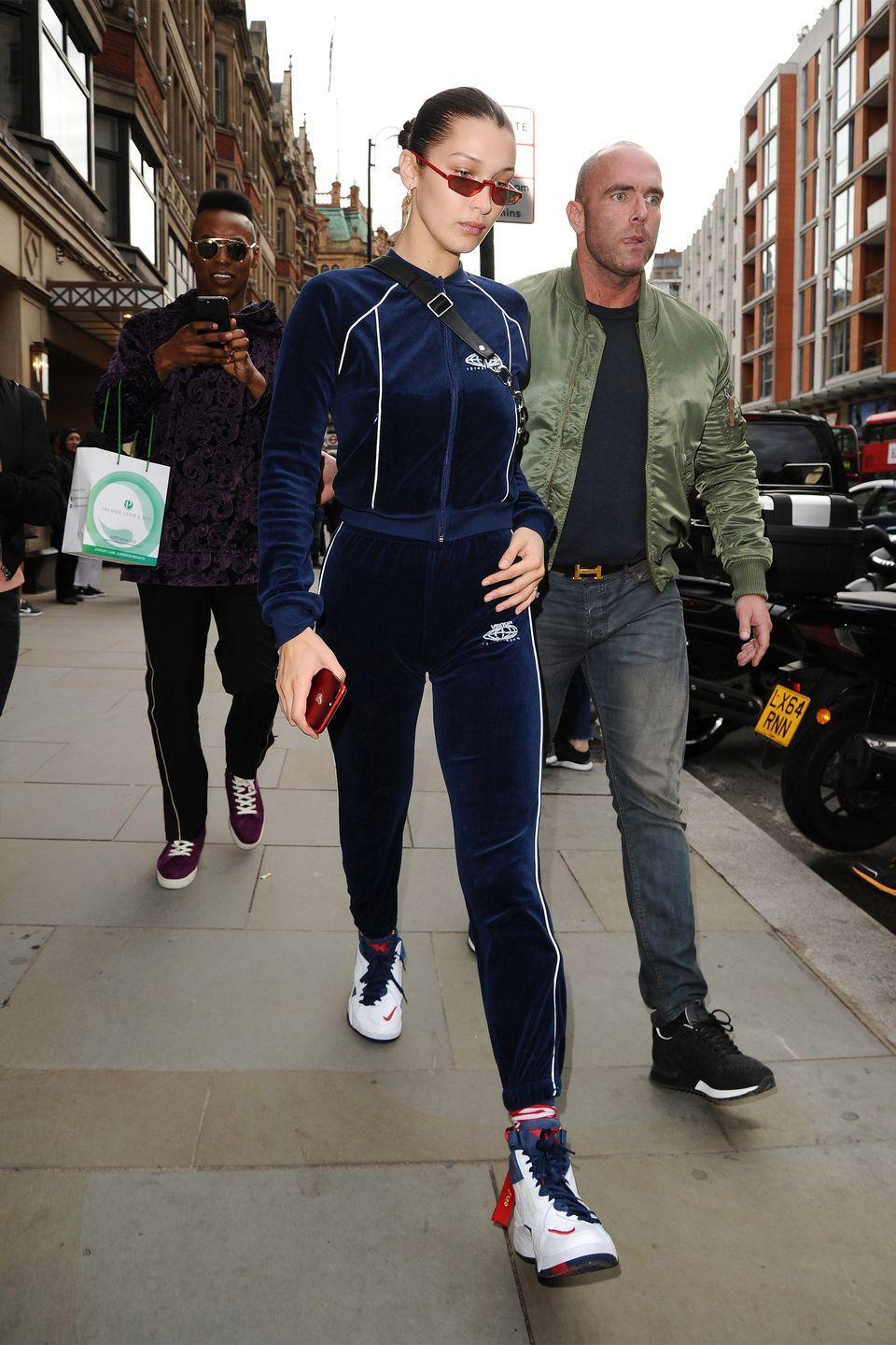 <p>In a Visitor on Earth tracksuit with Kith x Nike hightop sneakers, an Alexander Wang fanny pack, and Andy Wolf Ojala sunglasses while out in London.</p>