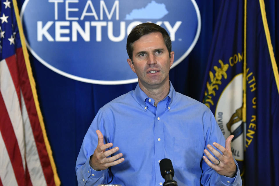 Kentucky Governor Andy Beshear addresses the media following the return of a grand jury investigation into the death of Breonna Taylor at the Kentucky State Capitol in Frankfort, Ky., Wednesday, Sept. 23, 2020. Gov. Beshear has made a request to the Kentucky Attorney General Daniel Cameron to release the grand jury transcripts to the public. (AP Photo/Timothy D. Easley)