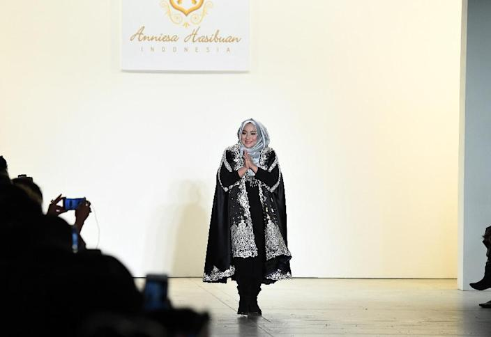 Indonesian designer Anniesa Hasibuan has developed a trademark style that complements the hijab with flowing, iridescent gowns (AFP Photo/Angela Weiss)