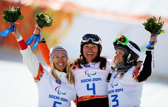 SOCHI, RUSSIA - MARCH 14: Gold medalist Bibian Mentel-Spee (C) of the Netherlands poses with silver medalist Cecile Hernandez Ep Cervellon (L) of France and bronze medalist Amy Purdy of the United States during the flower ceremony for the Women's Para Snowboard Cross Standing on day seven of the Sochi 2014 Paralympic Winter Games at Rosa Khutor Alpine Center on March 14, 2014 in Sochi, Russia. (Photo by Hannah Peters/Getty Images)