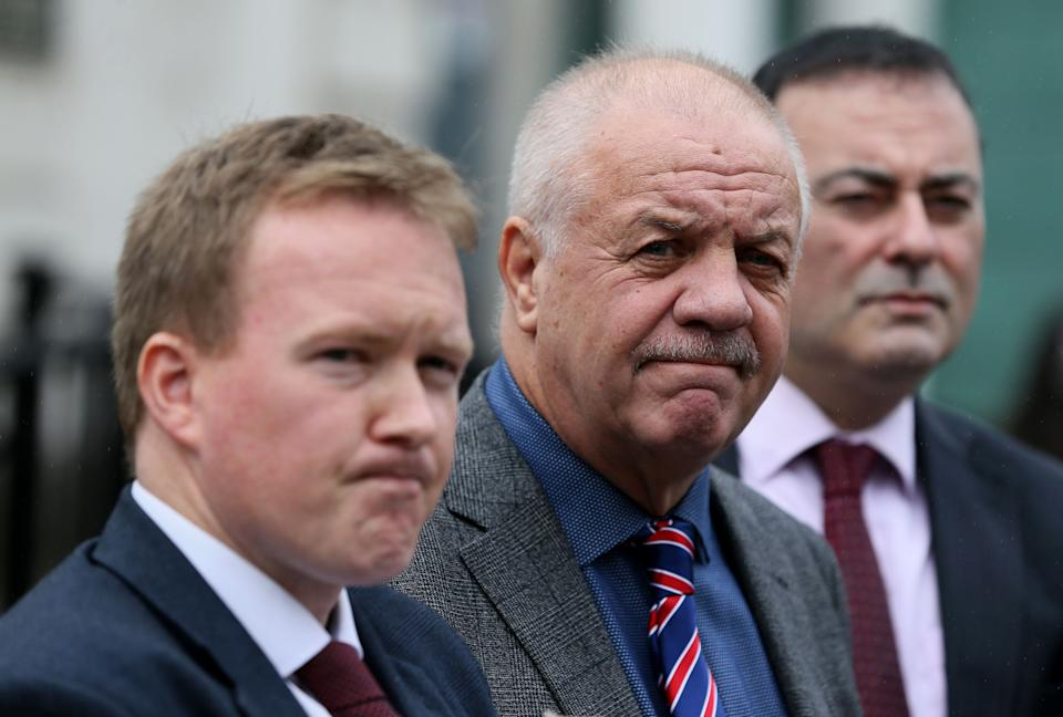<strong>Victims campaigner Raymond McCord (centre) with his lawyers outside of the High Court in Belfast </strong> (Photo: PA Wire/PA Images)