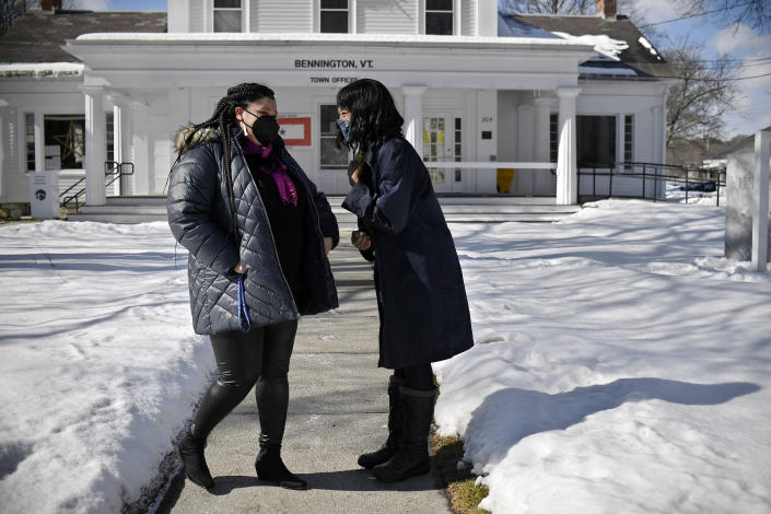 In this Saturday, Feb. 20, 2021, photo, Mia Schultz, president of the Rutland area branch of the NAACP, left, laughs with friend Tina Cook, right, outside Town Offices in Bennington, Vt. Schultz met to support Cook who was running for town Select Board. Cook came up short in the March 2 election in her effort to become the first African American elected to the board. (AP Photo/Jessica Hill)
