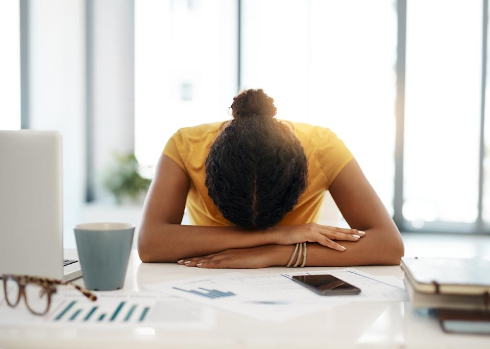 woman working from home with burnout