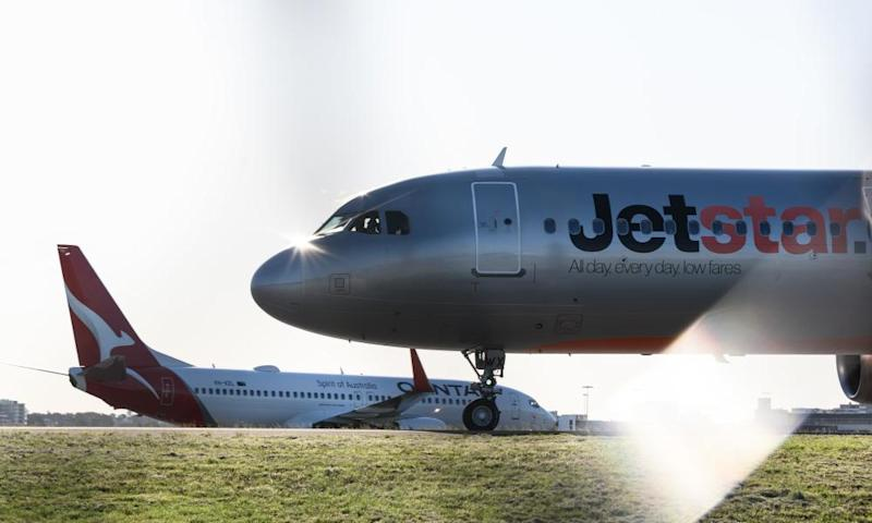Qantas and Jetstar slash fares and boost flights as border restrictions ease across Australia