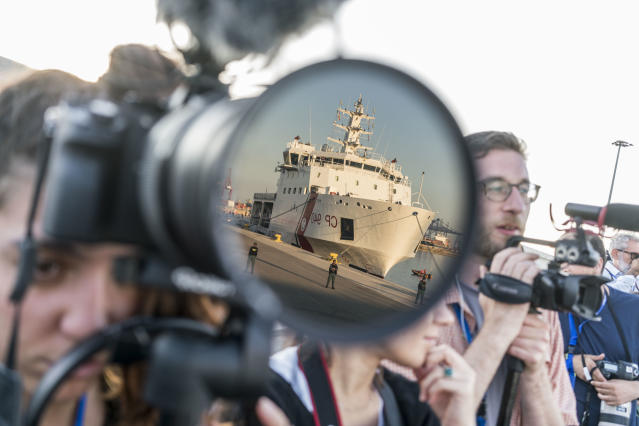 <p>The rescue ship Aquarius is reflected in a camera after arriving at the port of Valencia. (Photo: José Colón for Yahoo News) </p>