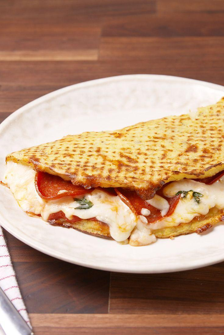 """<p>Low-carb never tasted so cheesy.</p><p>Get the recipe from <a href=""""/cooking/recipe-ideas/recipes/a51510/cauliflower-calzones-recipe/"""" data-ylk=""""slk:Delish"""" class=""""link rapid-noclick-resp"""">Delish</a>.</p>"""