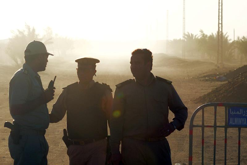 Egyptian policemen guard the road to Saint Samuel monastery in Minya province after the attack on a bus carrying Coptic Christians on May 26, 2017
