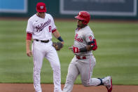 Philadelphia Phillies Jean Segura (2) runs past Washington Nationals shortstop Carter Kieboom (8) as he rounds bases after hitting a home run on the first pitch by Nationals starting pitcher Patrick Corbin during the first inning of a baseball game in Washington, Tuesday, Aug. 3, 2021. (AP Photo/Manuel Balce Ceneta)