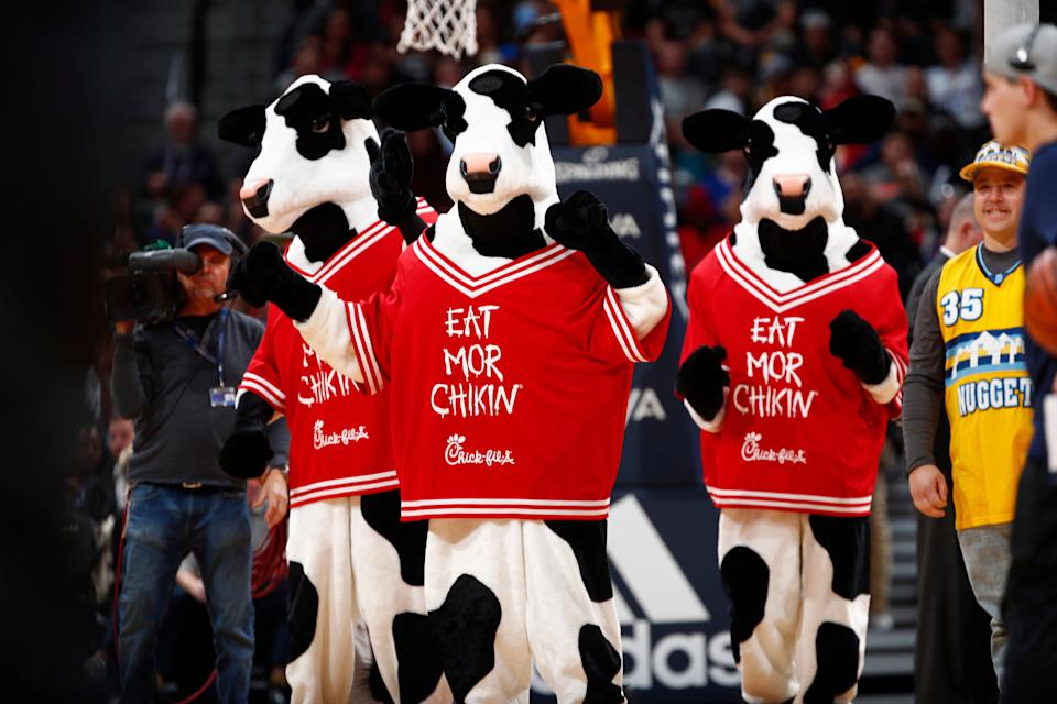 Chick-Fil-A cows perform in the overtime period second half of an NBA basketball game Friday, Dec. 15, 2017, in Denver. The Nuggets won 117-111 in overtime. (AP Photo/David Zalubowski)