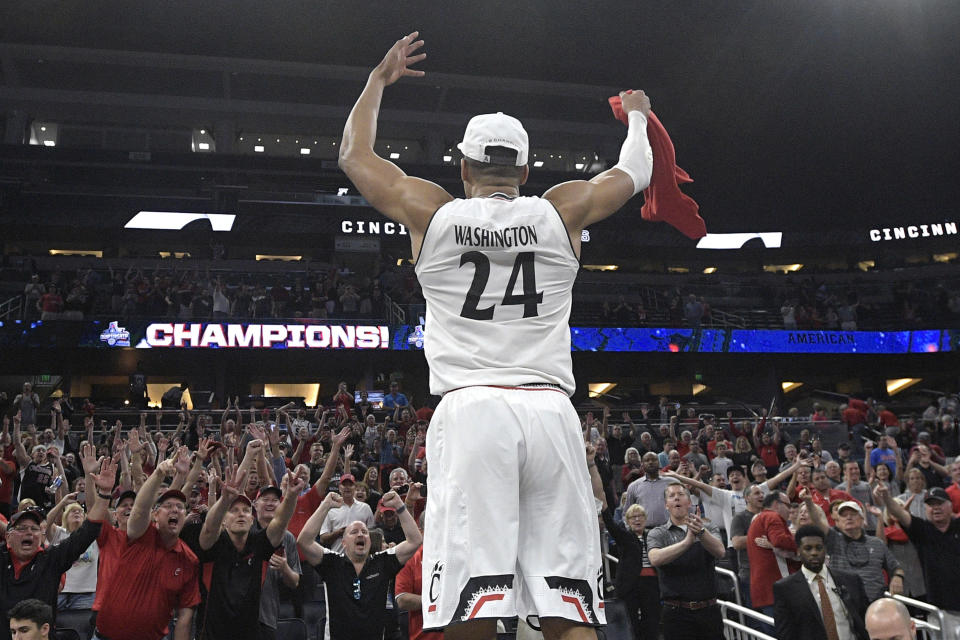 Cincinnati forward Kyle Washington (24) celebrates with fans in the stands after a 56-55 win over Houston during an NCAA college basketball championship game at the American Athletic Conference tournament Sunday, March 11, 2018, in Orlando, Fla. (AP Photo/Phelan M. Ebenhack)