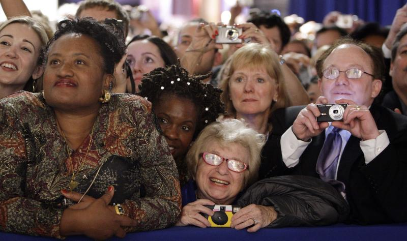 FILE - Dr. Ruth Westheimer, center, in the front-row watches President Barack Obama and first lady Michelle Obama at the Western Inaugural Ball in Washington, in this Jan. 20, 2009 file photo. The sideline events throughout inauguration weekend are the big draws for advocates and lobbyists looking to rub elbows with lawmakers and administration officials. The events at restaurants and hotels, museums and mansions are opportunities for anyone willing to write a check to turn a night out into a chance to build a Rolodex of Washington's powerbrokers. (AP Photo/Pablo Martinez Monsivais, File)