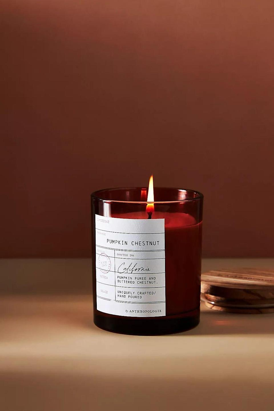 """<p><strong>Anthropologie</strong></p><p>anthropologie.com</p><p><strong>$24.00</strong></p><p><a href=""""https://go.redirectingat.com?id=74968X1596630&url=https%3A%2F%2Fwww.anthropologie.com%2Fshop%2Flibrary-card-glass-candle&sref=https%3A%2F%2Fwww.bestproducts.com%2Fhome%2Fg37377249%2Fbest-pumpkin-candles%2F"""" rel=""""nofollow noopener"""" target=""""_blank"""" data-ylk=""""slk:Shop Now"""" class=""""link rapid-noclick-resp"""">Shop Now</a></p><p>A match made in cozy heaven, this candle combines sweet and spicy pumpkin puree with smoky, buttery chestnuts along with amber notes. </p><p>It's a very elegant scent but still so fun to spark, and we love the library-card label adorning its jewel-tone glass votive.</p>"""
