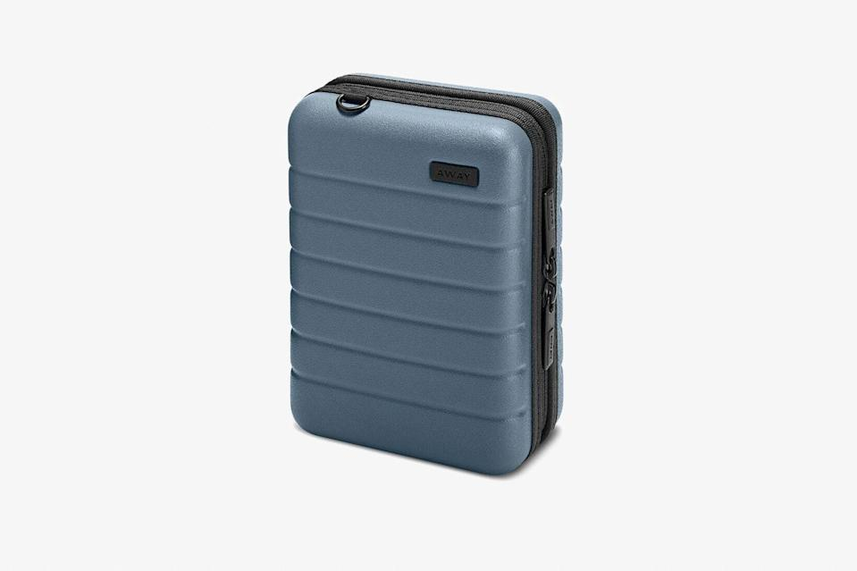 """Is there anything cuter than a miniature version of your go-to luggage? We think not. This <a href=""""https://www.cntraveler.com/galleries/2012-07-25/best-travel-luggage-suitcase-samsonite-rimowa?mbid=synd_yahoo_rss"""" rel=""""nofollow noopener"""" target=""""_blank"""" data-ylk=""""slk:hard-sided case"""" class=""""link rapid-noclick-resp"""">hard-sided case</a> may be small, but it's just roomy enough to fill up with toiletries, tech accessories, or the jumble of in-flight necessities that usually float around the bottom of your travel bag. $45, Away. <a href=""""https://www.awaytravel.com/minis/the-mini"""" rel=""""nofollow noopener"""" target=""""_blank"""" data-ylk=""""slk:Get it now!"""" class=""""link rapid-noclick-resp"""">Get it now!</a>"""
