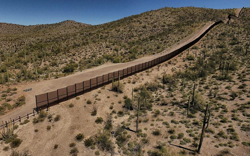View of the metal fence along the border in Sonoyta, Sonora state, northern Mexico, between the Altar desert in Mexico and the Arizona desert in the United States, on March 27, 2017. (Photo: PEDRO PARDO/AFP via Getty Images)