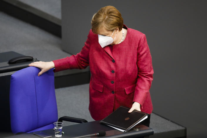 German Chancellor Angela Merkel takes her seat after her speech during a parliament session about a new law to battle the coronavirus pandemic at the parliament Bundestag in Berlin, Germany, Friday, April 16, 2021. (AP Photo/Markus Schreiber)