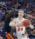 <p>Florida guard Canyon Barry (24) goes up for a shot against Virginia guard Marial Shayok during the first half of a second-round game of the NCAA men's college basketball tournament, Saturday, March 18, 2017, in Orlando, Fla. (AP Photo/Wilfredo Lee) </p>
